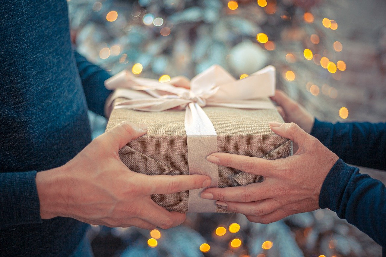 person giving house warming gifts
