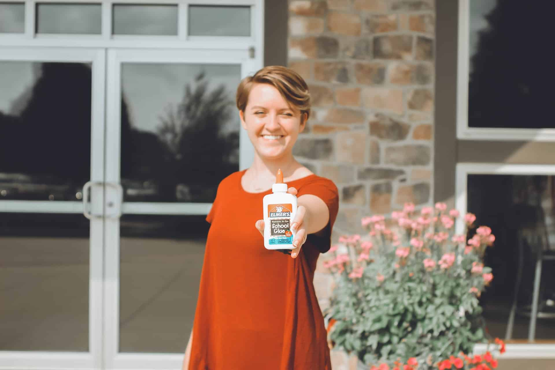 woman holding a glue in hand