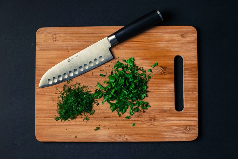 santoku knife on a cutting board